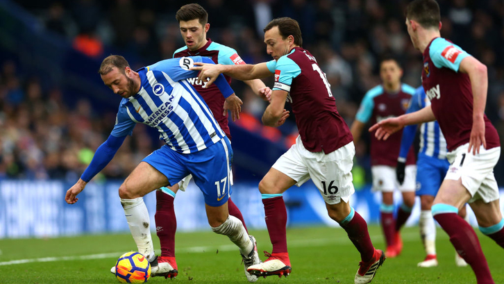 BRIGHTON, ENGLAND - FEBRUARY 03: Glenn Murray of Brighton and Hove Albion breaks away from Mark Noble of West Ham United during the Premier League match between Brighton and Hove Albion and West Ham United at Amex Stadium on February 3, 2018 in Brighton, England. (Photo by Steve Bardens/Getty Images)