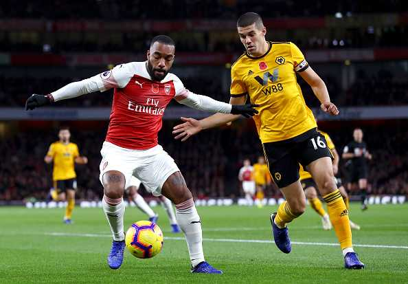 LONDON, ENGLAND - NOVEMBER 11: Alexandre Lacazette of Arsenal battles for possession with Conor Coady of Wolverhampton Wanderers during the Premier League match between Arsenal FC and Wolverhampton Wanderers at Emirates Stadium on November 11, 2018 in London, United Kingdom. (Photo by Clive Rose/Getty Images)