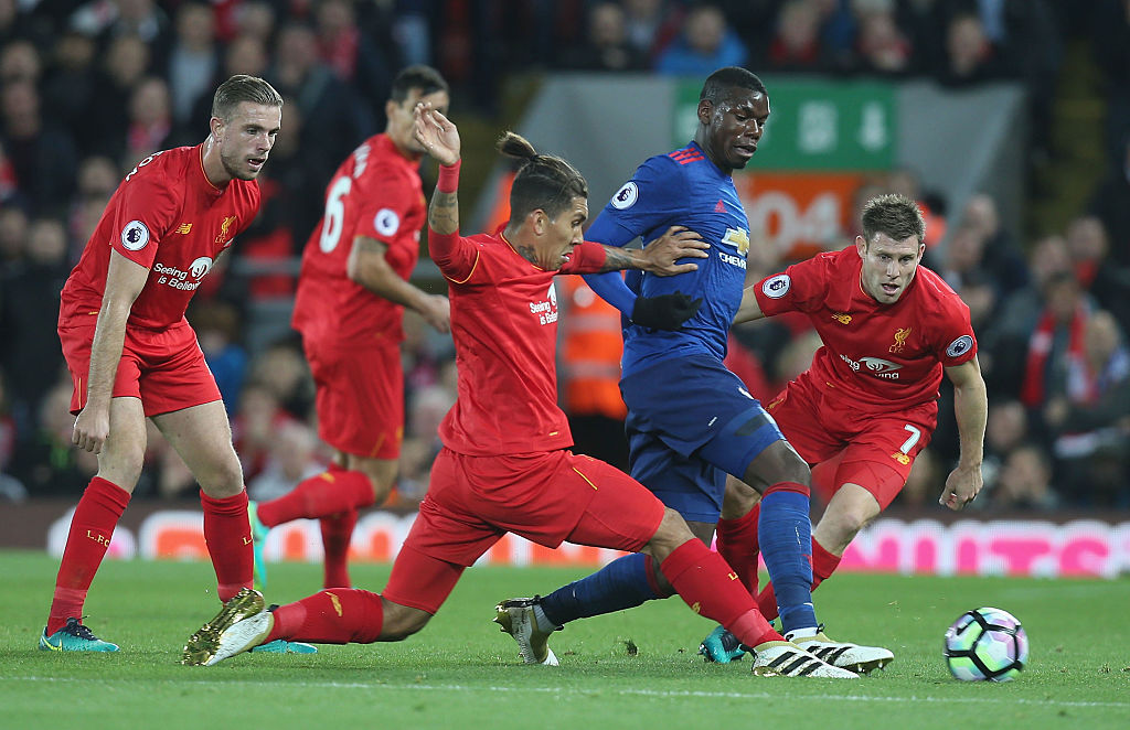 LIVERPOOL, ENGLAND - OCTOBER 17: Paul Pogba of Manchester United in action with Roberto Firmino and James Milner of Liverpool during the Premier League match between Liverpool and Manchester United at Anfield on October 17, 2016 in Liverpool, England. (Photo by Matthew Peters/Manchester United via Getty Images)