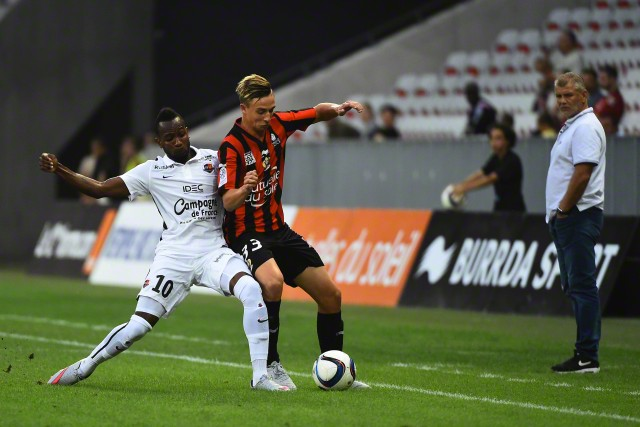 22 Aug 2015, Nice, France, France --- epa04893383 Olivier Boscagli of OGC Nice (R) vies for the ball with Lenny Nangis of Caen (L) during the French Ligue 1 soccer match between OGC Nice and Lille OSC at the Allianz Riviera, in Nice, France, 22 August 2015. EPA/OLIVIER ANRIGO --- Image by © OLIVIER ANRIGO/epa/Corbis